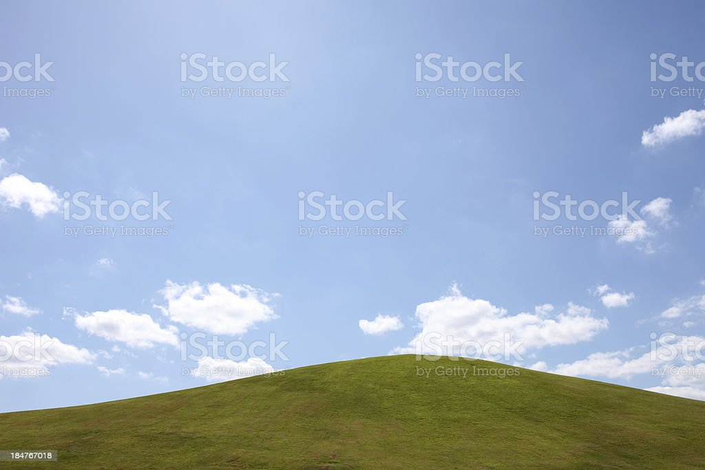 green hill with blue sky and cloud stock photo
