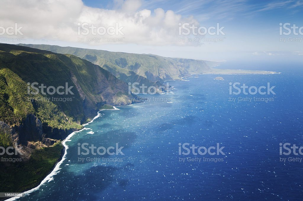 Green hills of Molokai island coastline. stock photo