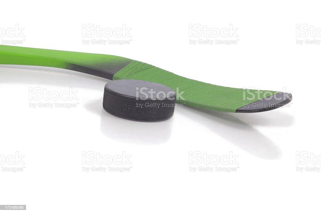 Green hockey stick on ice royalty-free stock photo