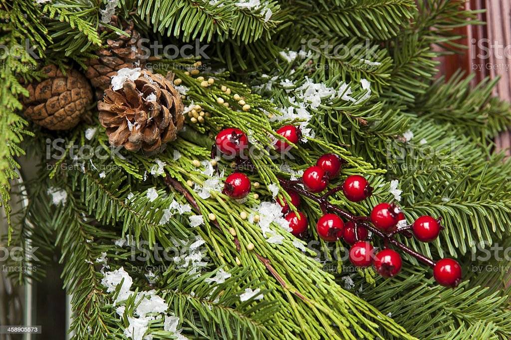 Green holiday Christmas decoration with snow stock photo