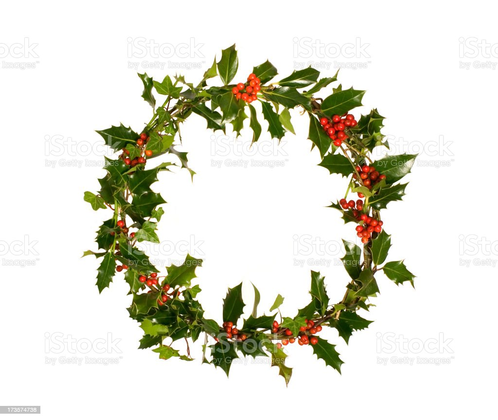 Green holly wreath with red berries stock photo