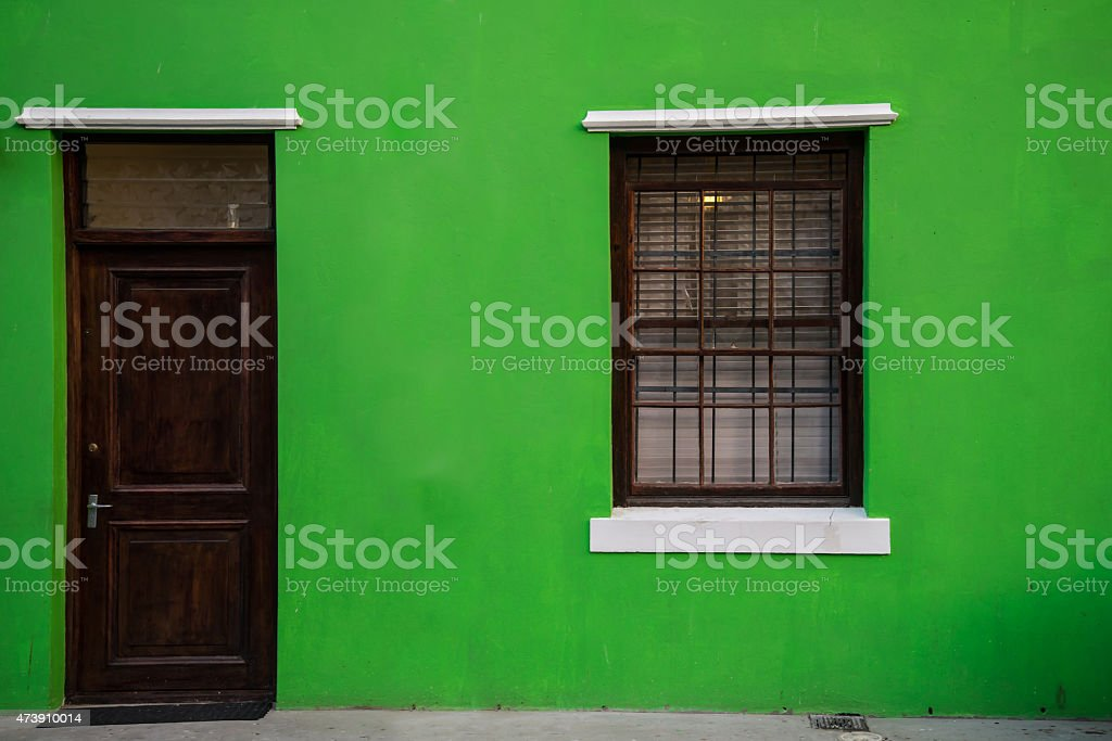 Green home in historic Bo-Kaap neighborhood in Cape Town stock photo