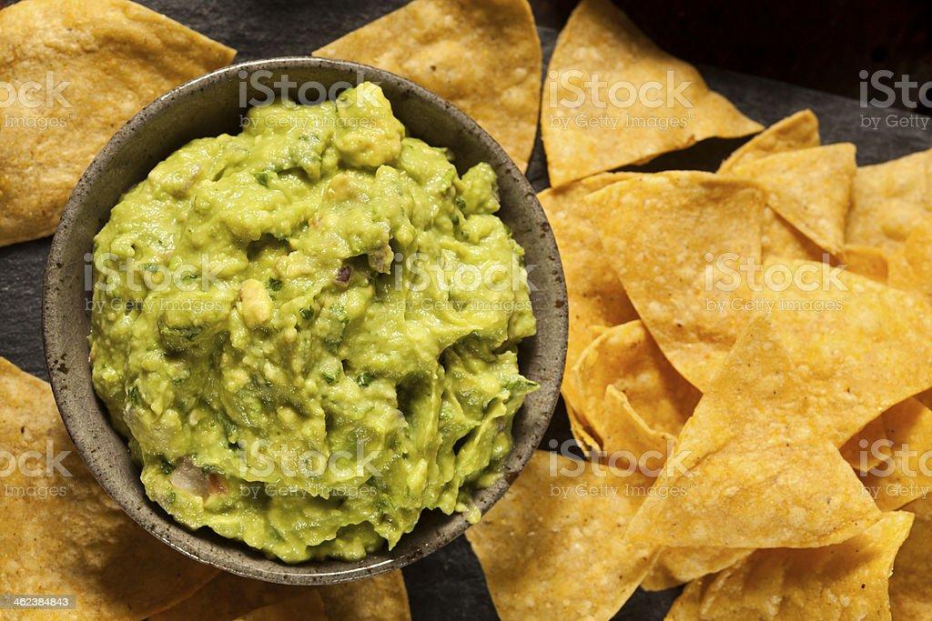Green Homemade Guacamole with Tortilla Chips stock photo