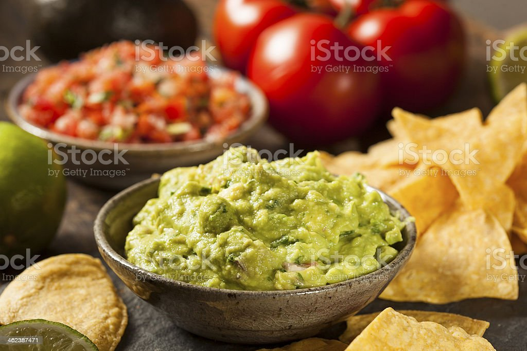 Green Homemade Guacamole with Tortilla Chips stock photo