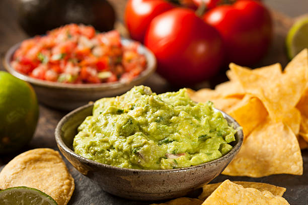 Green Homemade Guacamole with Tortilla Chips Green Homemade Guacamole with Tortilla Chips and Salsa salsa sauce stock pictures, royalty-free photos & images