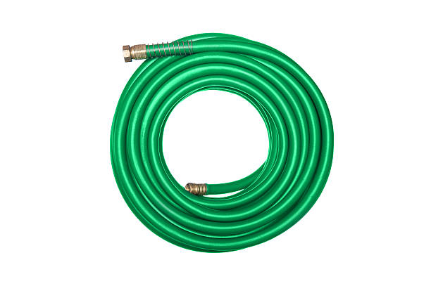 green hose isolated on white - garden hose stock pictures, royalty-free photos & images