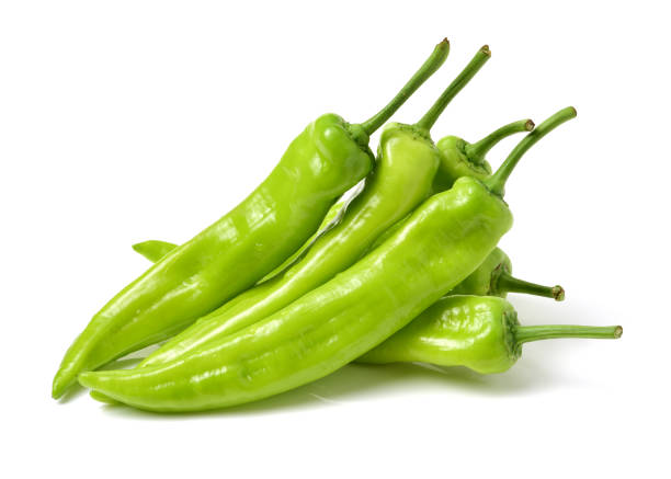 green hot chili peppers  on white background - green chilli pepper stock photos and pictures