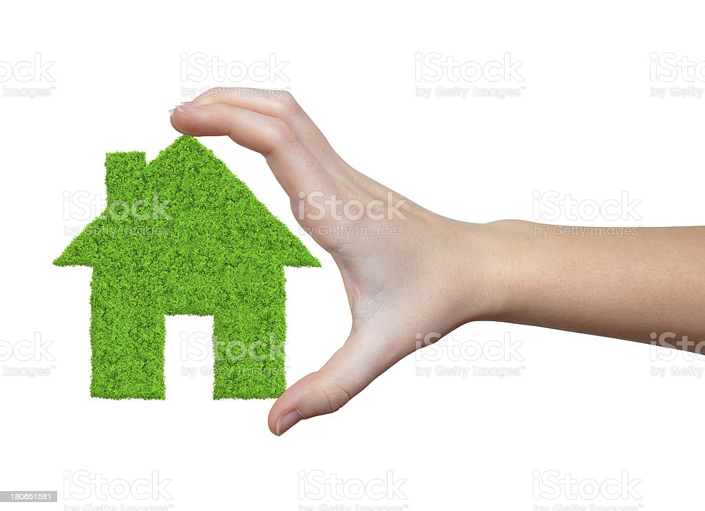 green house in hands royalty-free stock photo