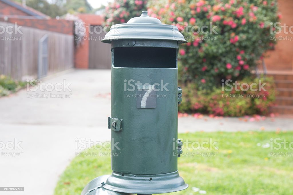 Green house mailbox number seven. stock photo