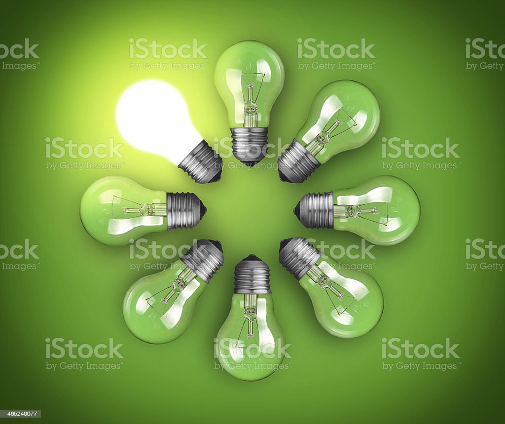 Green idea concept with one bulb lighting the rest stock photo