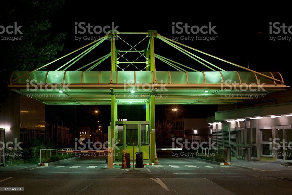 Green illuminated entrance gate stock photo