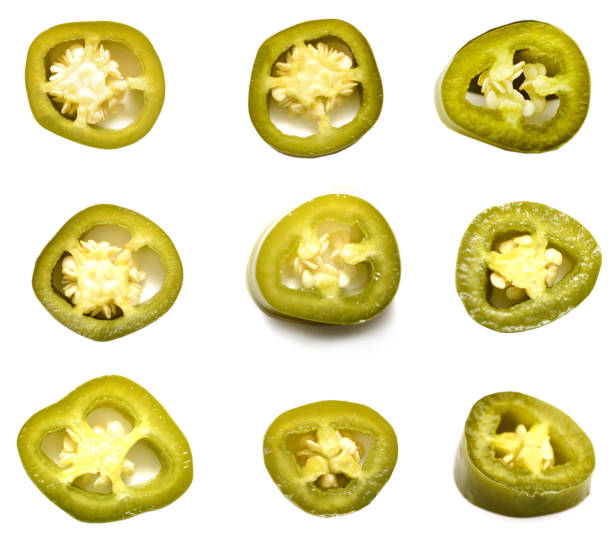 green jalapeno pepper slices isolated white background green jalapeno pepper slices isolated white background jalapeno pepper stock pictures, royalty-free photos & images