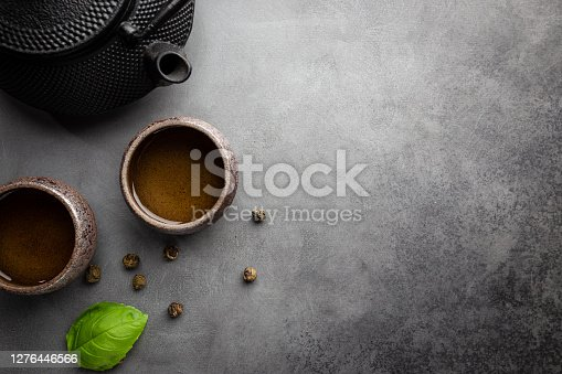 Green japanese tea on black stone table. Top view with copy space