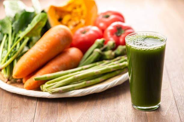 Green juice Green juice vegetable juice stock pictures, royalty-free photos & images