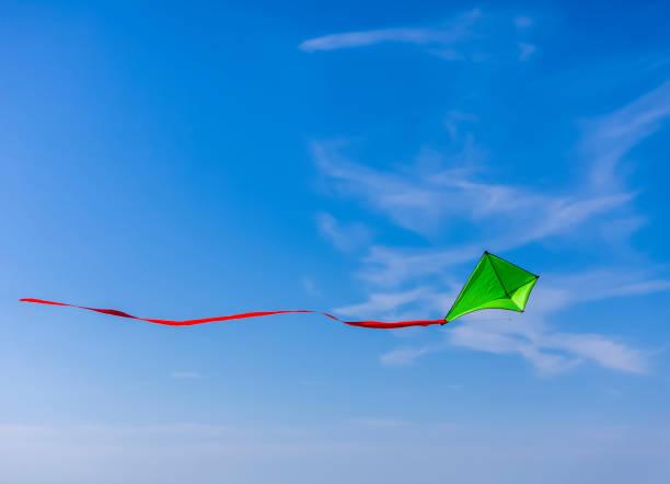 Green Kite Flying stock photo