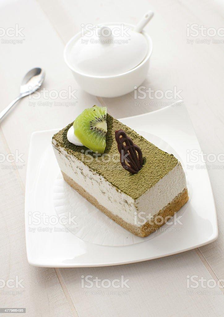 Green kiwi and chocolate decor cake royalty-free stock photo