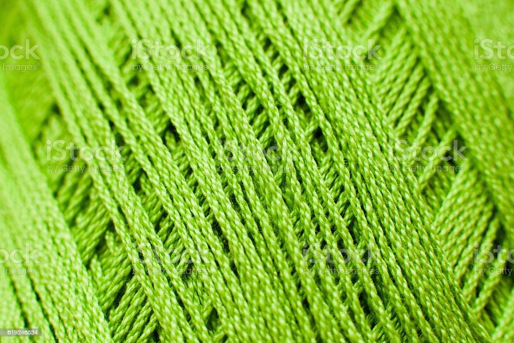 Green knitting thread texture, handiwork backdrop stock photo