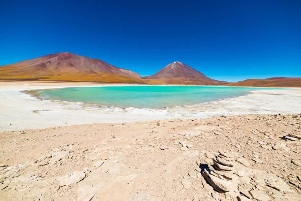 "Green Lagoon or ""Laguna Verde"", frozen salt lakeroad trip to the famous Uyuni Salt Flat, travel destination in Bolivia. Snowcapped Licancabur Volcano, 5920 m, in the background. stock photo"