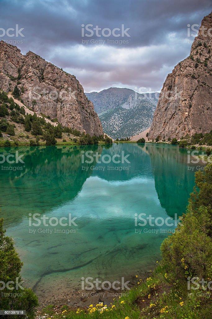 green lake in mountains stock photo