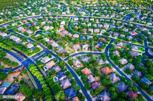 istock Green landscape Vast Homes and Thousands of Houses Modern Suburb Development 982589004