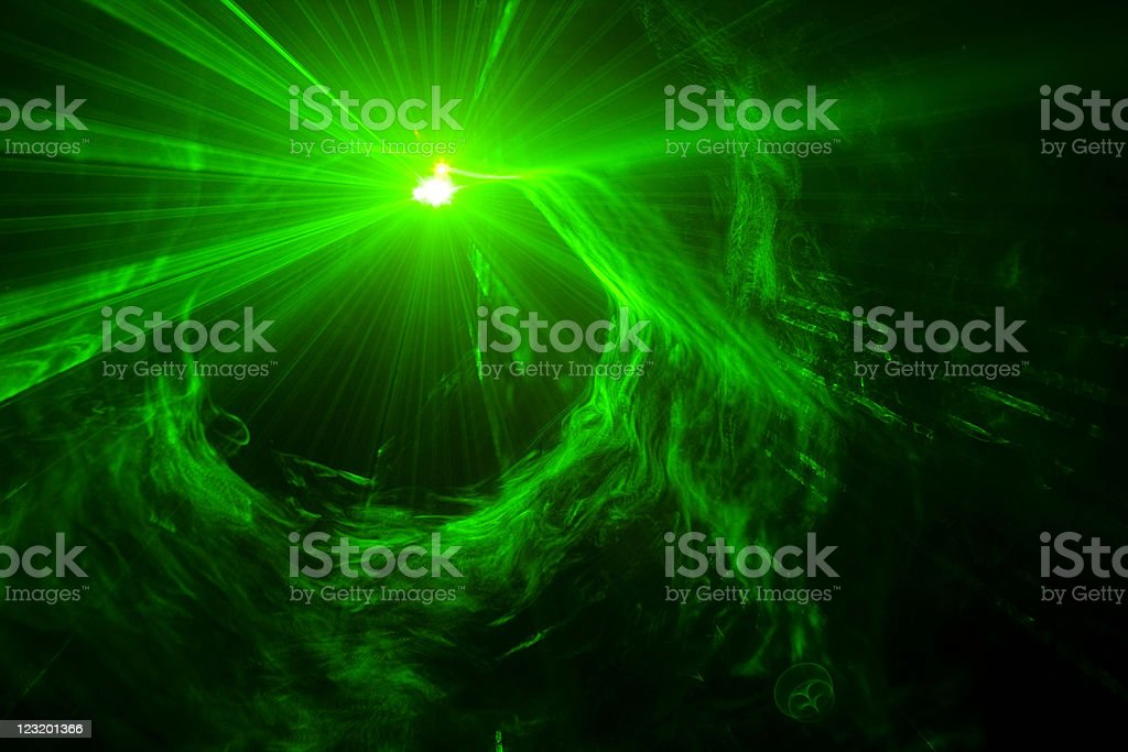 Green laser light with smoke and strobe effect stock photo