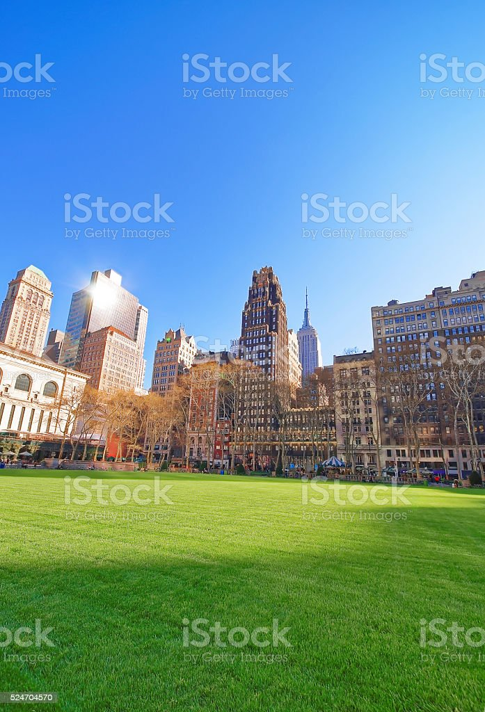 Green Lawn and Skyline with Skyscrapers in Bryant Park stock photo