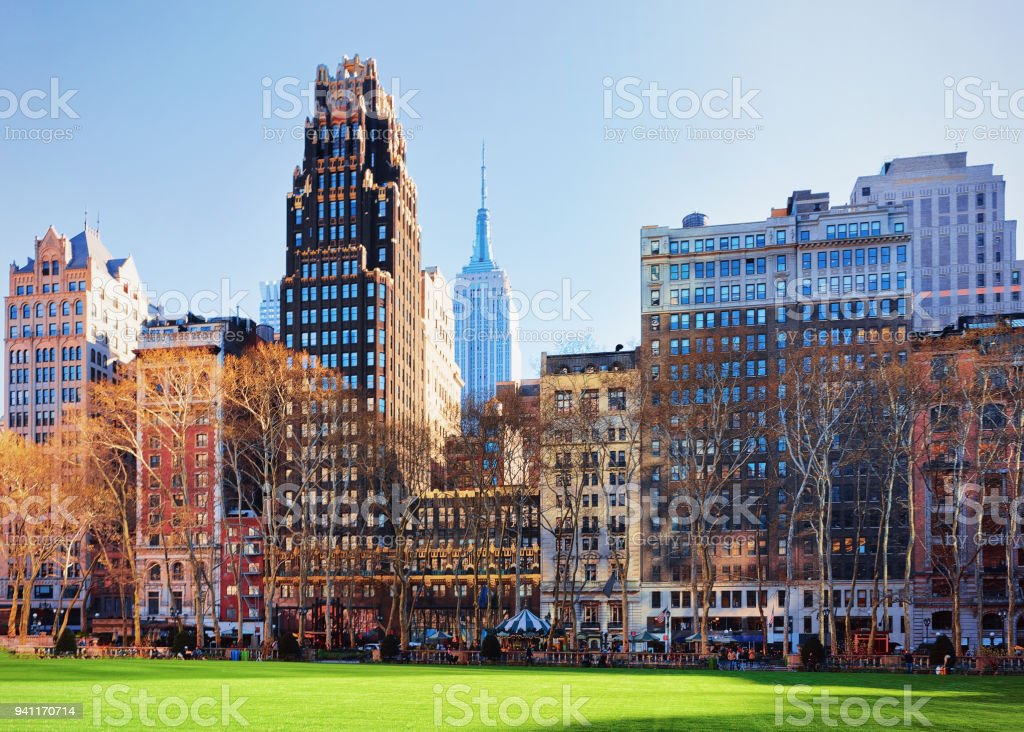 Green Lawn and Skyscrapers in Bryant Park Manhattan NY stock photo