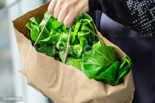 Green leaf lettuce in the bag with natural light in the morning Stock photo