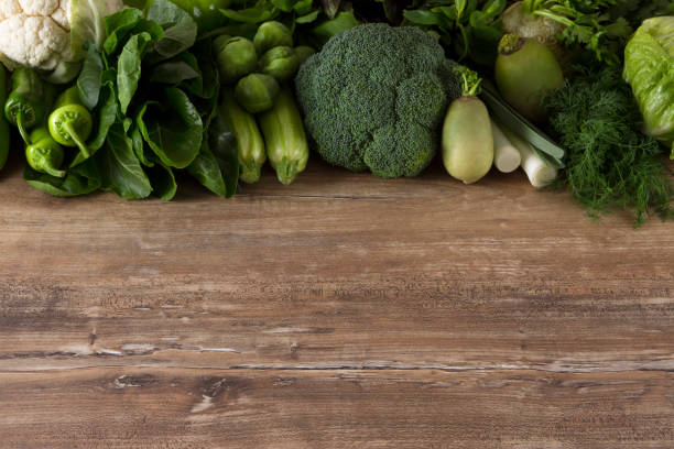 Green Leaf Vegetables on Kitchen Table stock photo