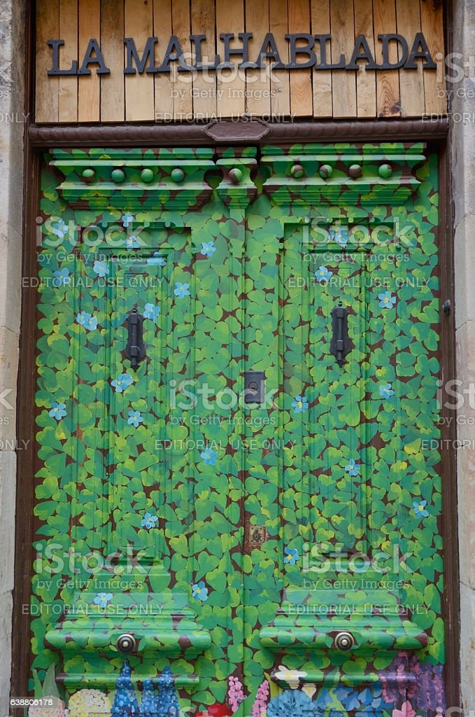 Green leafes painted door stock photo