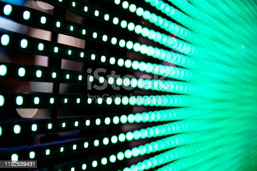 932724974 istock photo green LED dots screen 1132539431