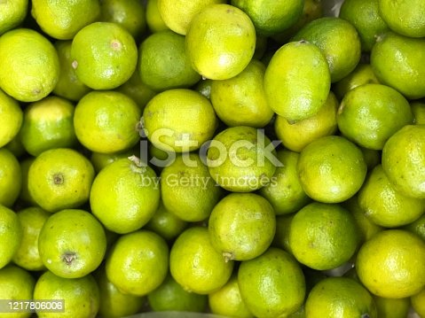 Green lemon close view lemos is an important citrus fruit and is a vital source of vitamin c