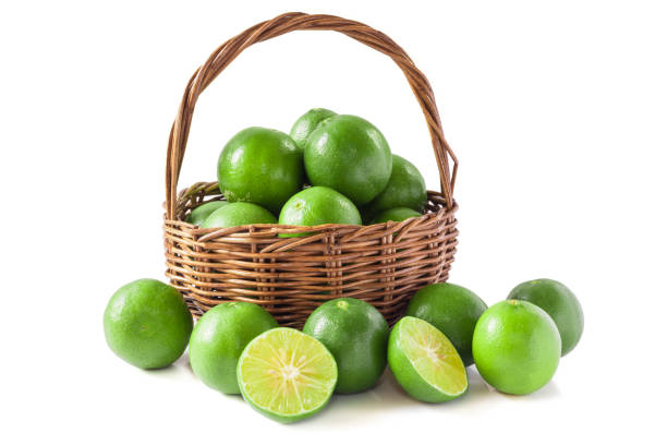 Green lemon in the basket isolated background stock photo
