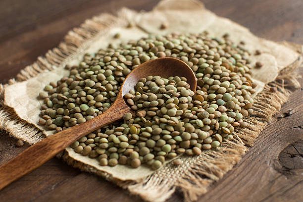 Green lentils with a spoon stock photo