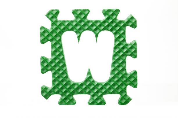 green letter w puzzle piece green letter w puzzle piece letter w stock pictures, royalty-free photos & images