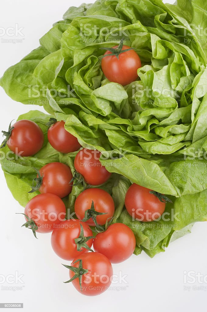 Green lettuse salad and tomato fresh food isolated over white royalty-free stock photo