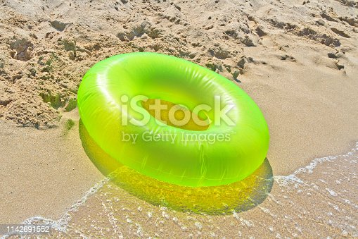 green life buoy on the seaside