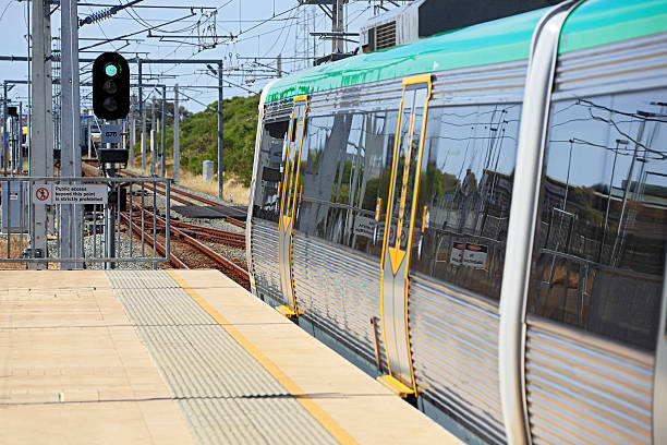 green light for electric metro train in station platform - railway signal stock photos and pictures