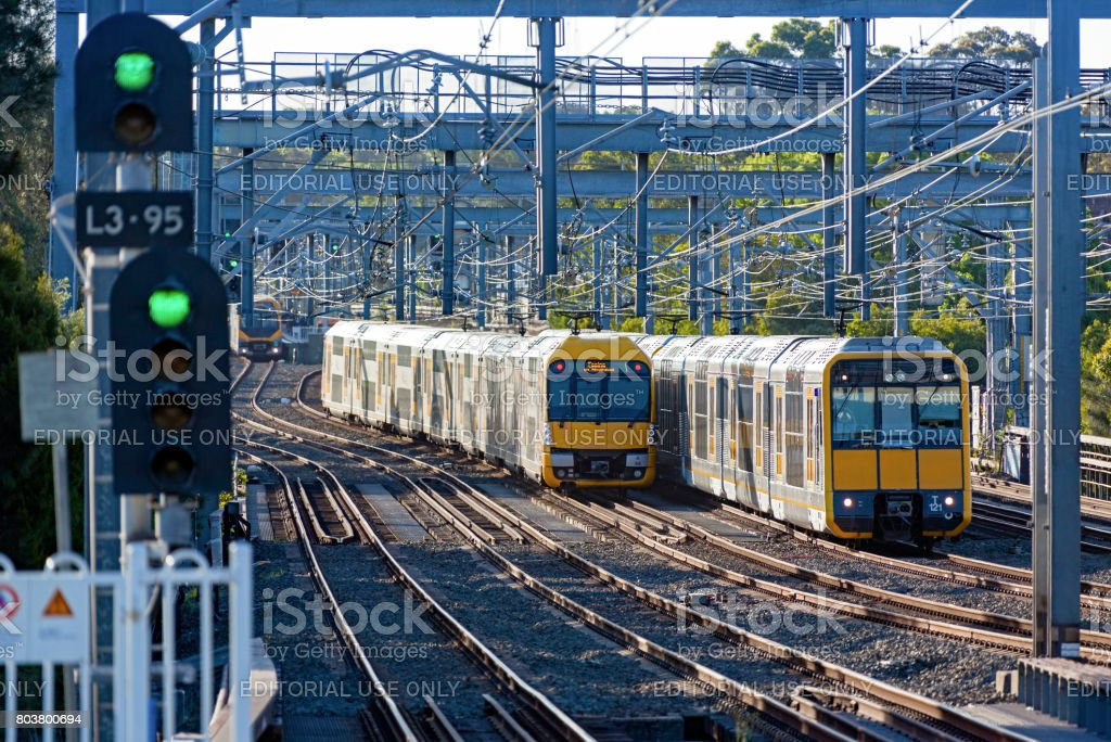 Green lights and Sydney Trains rush hour suburban commuter services stock photo