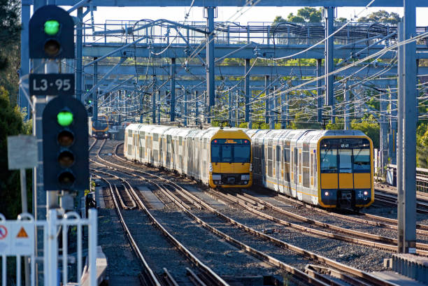 green lights and sydney trains rush hour suburban commuter services - railway signal stock photos and pictures