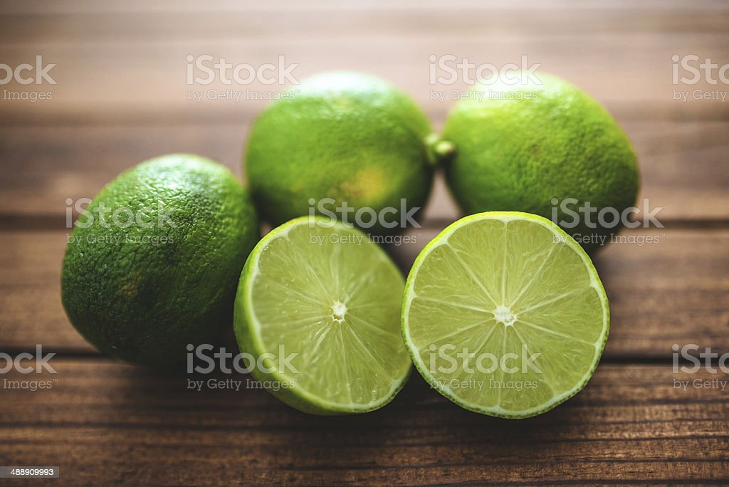 green lime on vintage plank wood stock photo