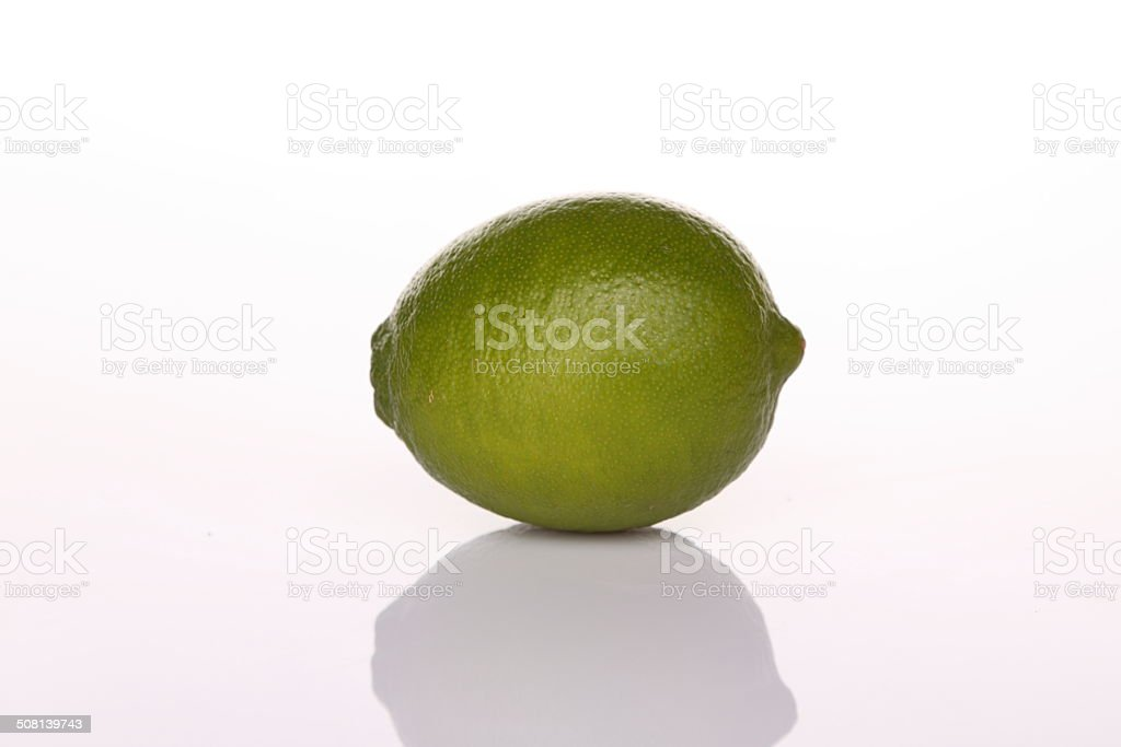 Green lime with shadow stock photo