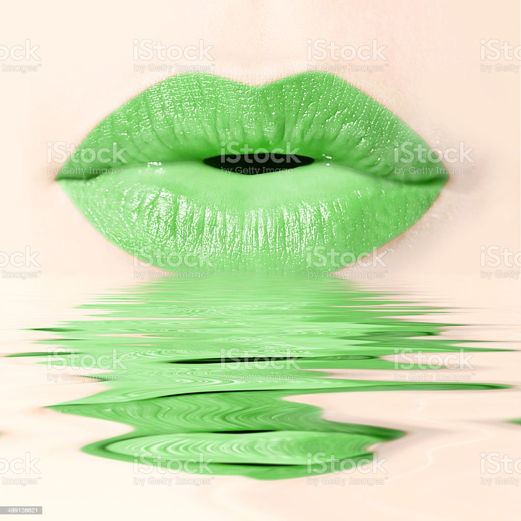 Green lips and reflections stock photo
