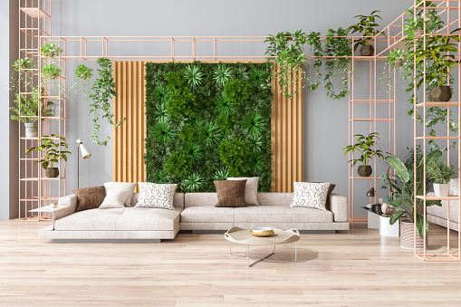 Green Living Room With Vertical Garden, House Plants, Beige Color Sofa And Parquet Floor