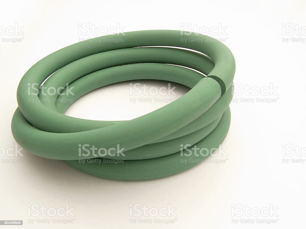 Green LPG rubber tube on white background royalty-free stock photo