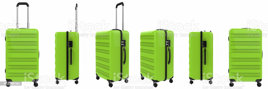 green luggages in a row stock photo