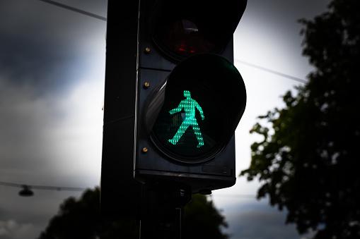 Green man walking traffic light at a city crosswalk.