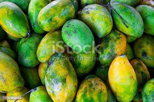 Sweet tasty mango in market - fruit background