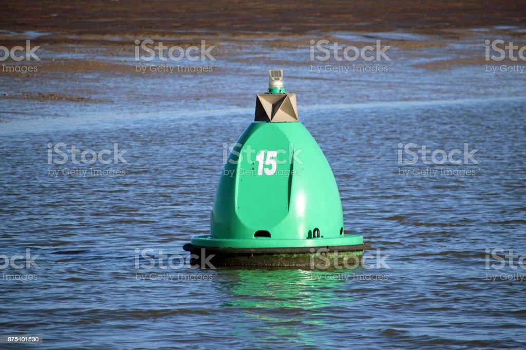 Green marker buoy stock photo