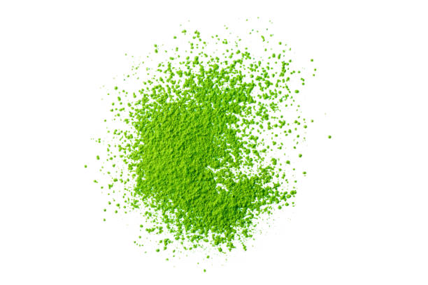 green matcha tea powder isolated on white background stock photo
